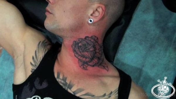 Adorable Black Rose Tattoo On Neck