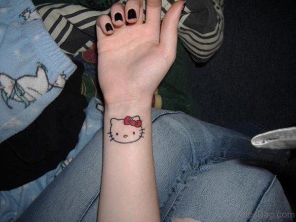 Adorable kitty Wrist Tattoo