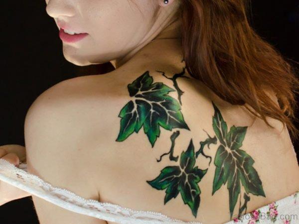 Amazing Green Leaf Tattoo On Upper Back