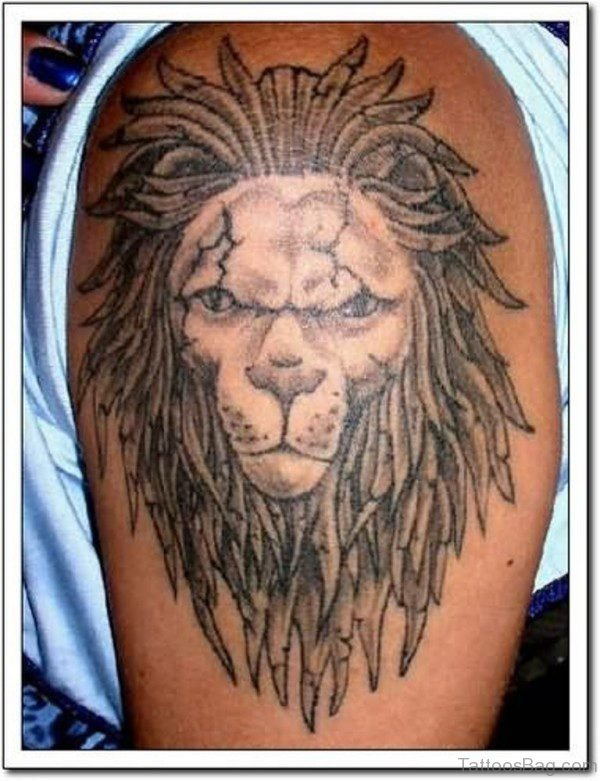 Amazing Lion Face Tattoo On Left Shoulder