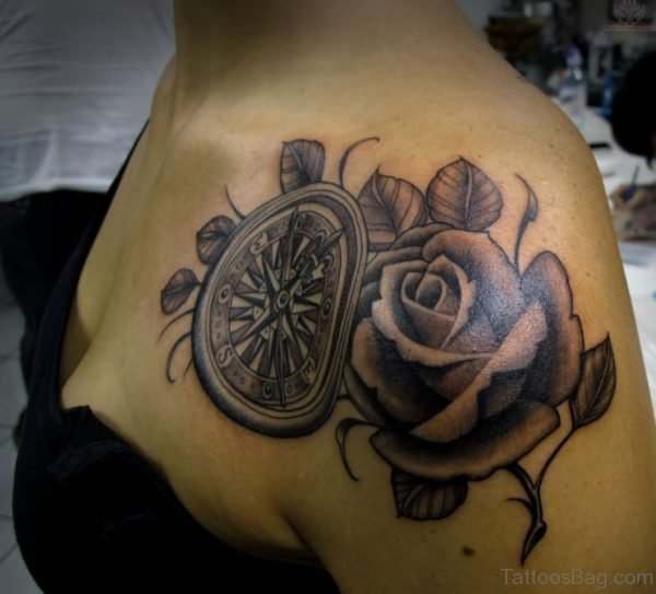 Amazing Rose And Wheel Tattoo Design