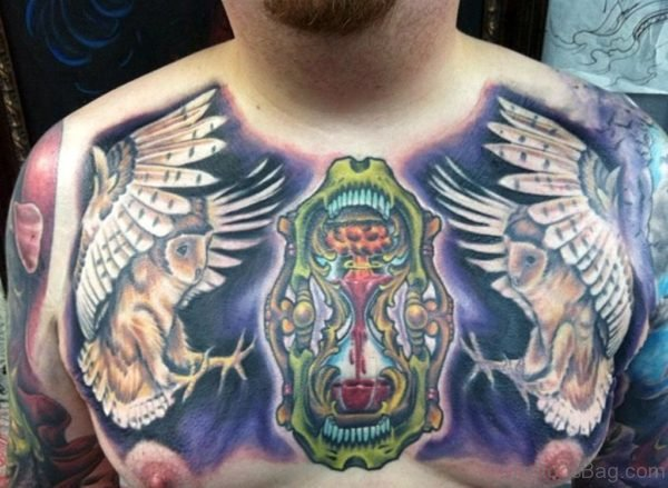 Amazing Watercolor Hourglass With Flying Owl Tattoo On Man Chest