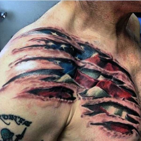 American Flag Ripping Skin Tattoo On Front Shoulder