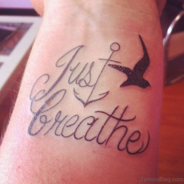Anchor And Just Breathe Wording Tattoo