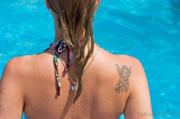Angel On Shoulder Back Tattoo