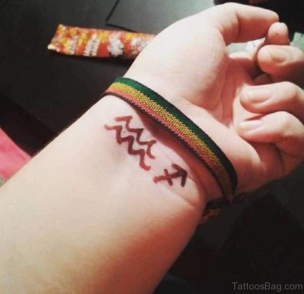 Aquarius Zodiac Symbol Tattoo On Wrist