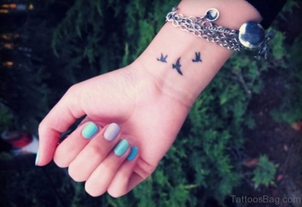 Attractive Black Birds Tattoo