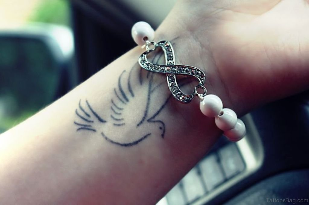49 Creative Dove Tattoos On Wrist