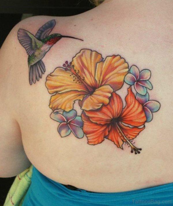 Attractive Flower And Hummingbird Tattoo