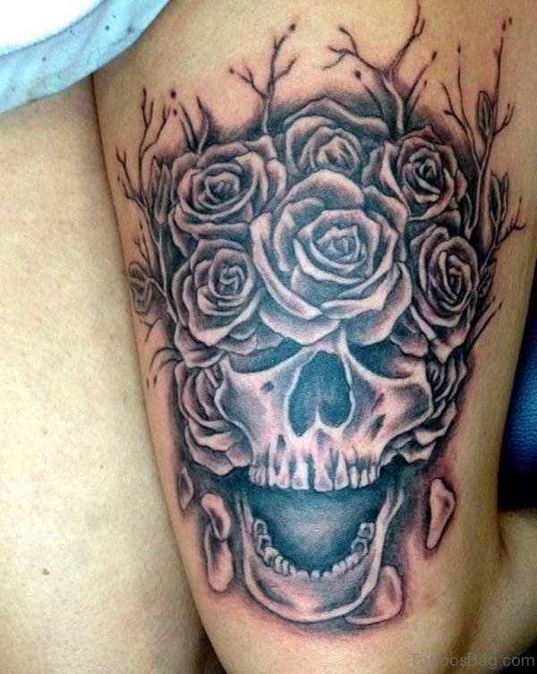 Attractive Rose And Skull Tattoo