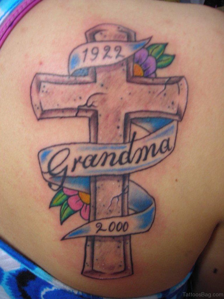 49 classy banner tattoos for back for Flower cross tattoo