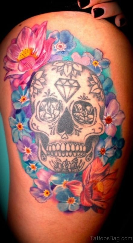 Awesome Colored Flowers Skull Thigh Tattoo