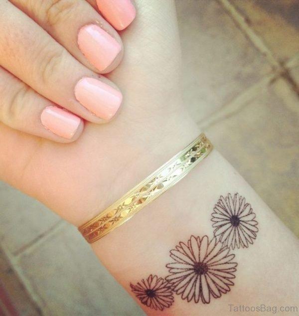 Daisy Flower Wrist Tattoo