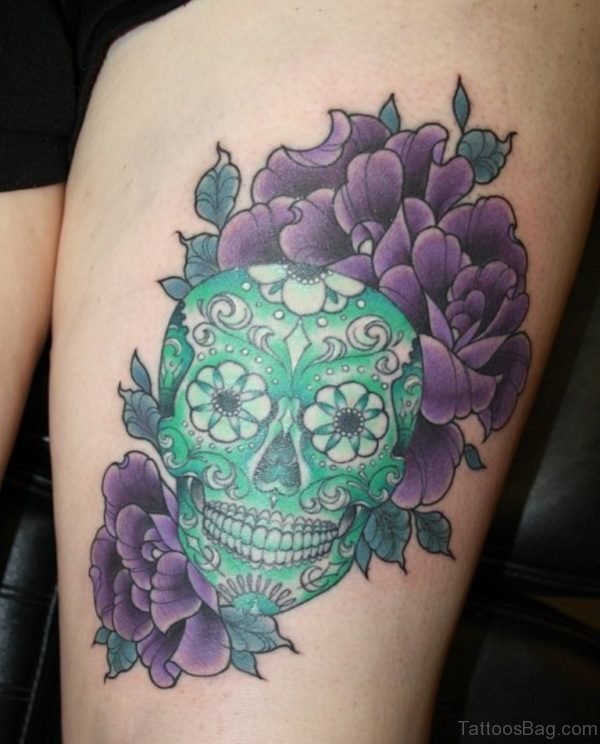 Green Skull Tattoo On Thigh