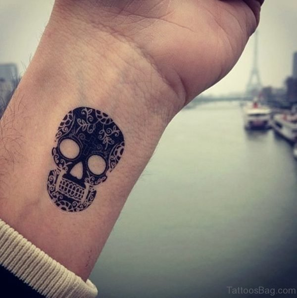Awesome 2D Skull Tattoo On Wrist