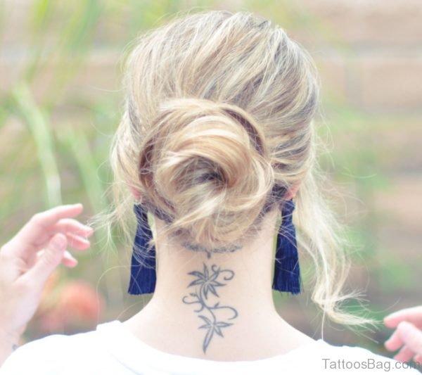 Back Neck Flower Tattoo