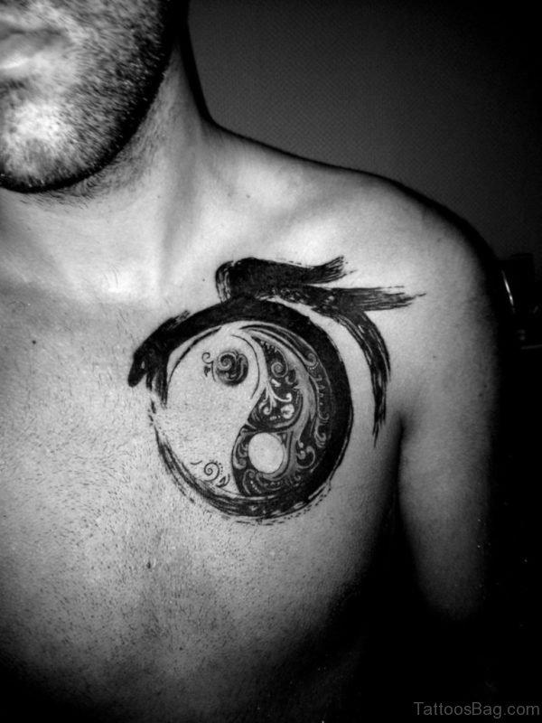 Black Yin Yang Tattoo On Front Shoulder