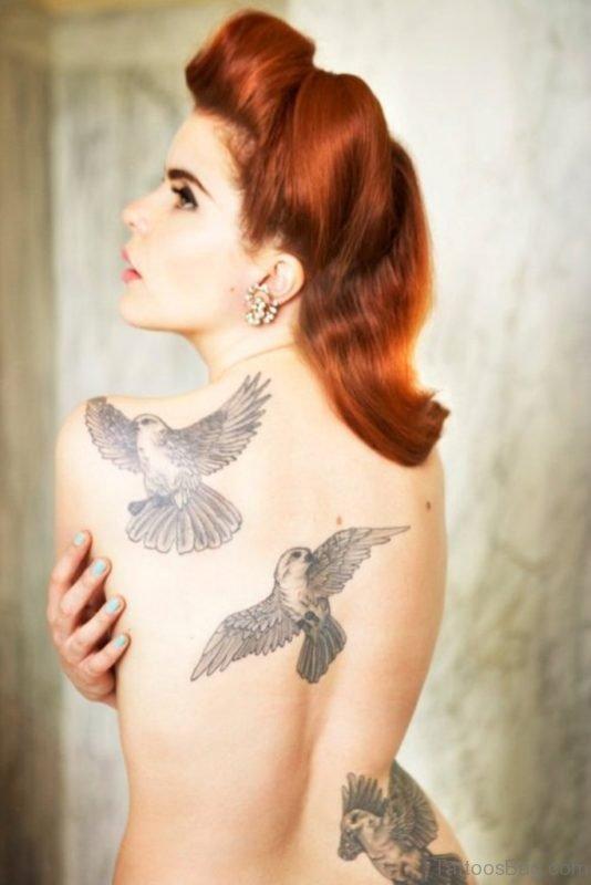 Beautiful Flying Birds Tattoo On Back