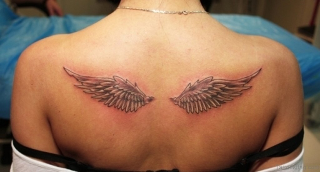 60 most amazing memorial angel tattoos for back for Angel wings girl tattoos
