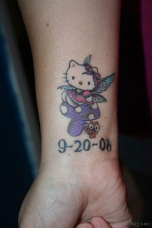Beautiful And Dated kitty Wrist Tattoo