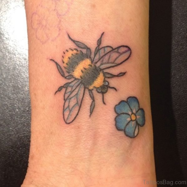 Bee And Small Blue Flower Tattoo