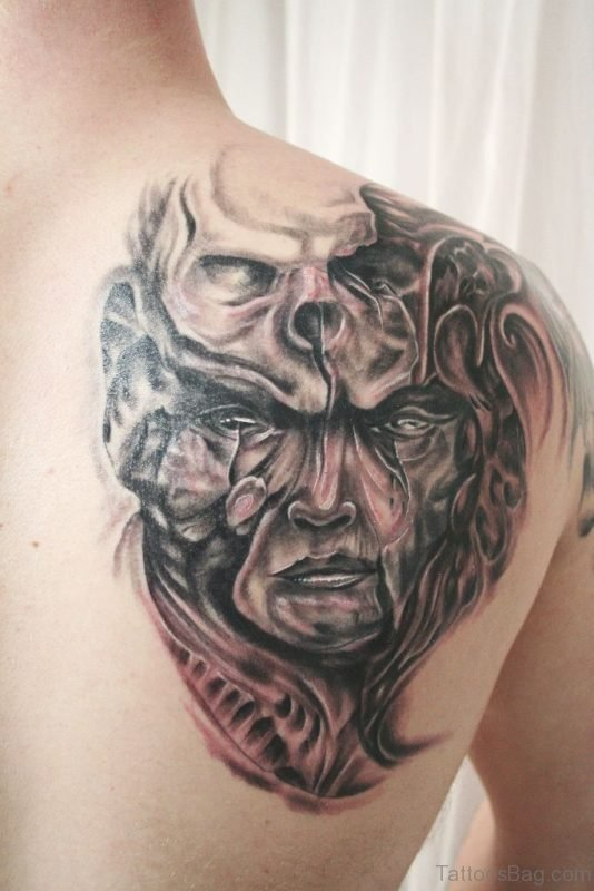 Biomechanical Face Tattoo
