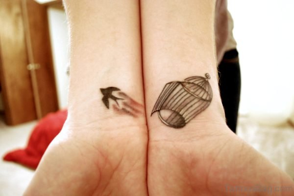 Bird And Cage Tattoo On Wrist