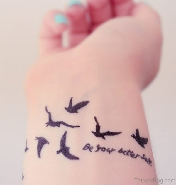 Birds And Wording Tattoo On Wrist