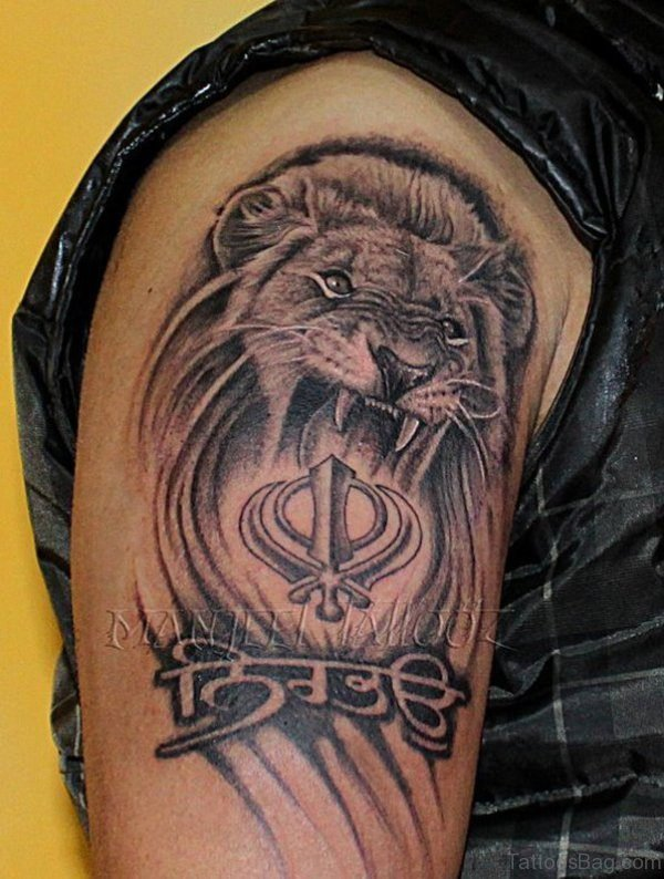 Black And Grey Lion Shoulder Tattoo