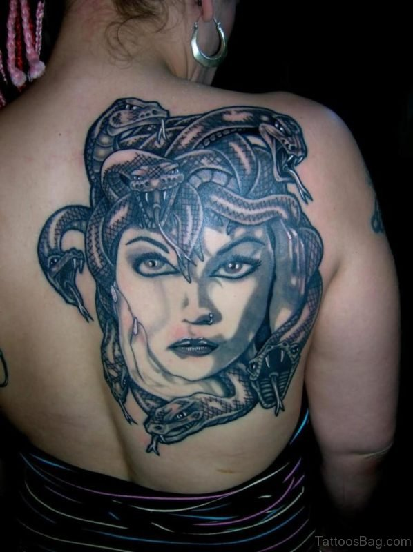 Black And Grey Medusa Face Tattoo