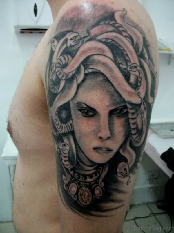 Black And Grey Medusa Tattoo On Man Left Shoulder