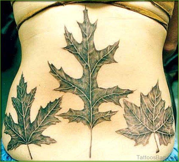 Black And Grey Three Maple Leaf Tattoo On Back