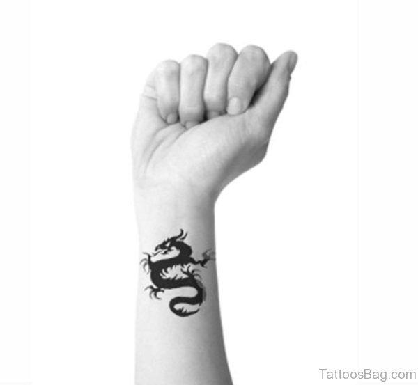 Black And White Dragon Wrist Tattoo