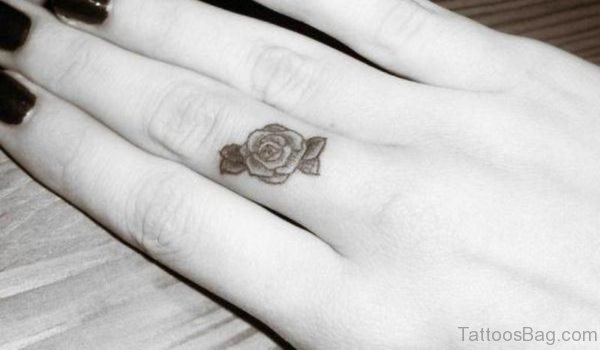 Black And White Rose Finger Tattoo