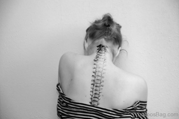 Black And White Spine Tattoo