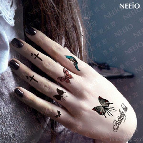 Black Cross Tattoo Design On Finger