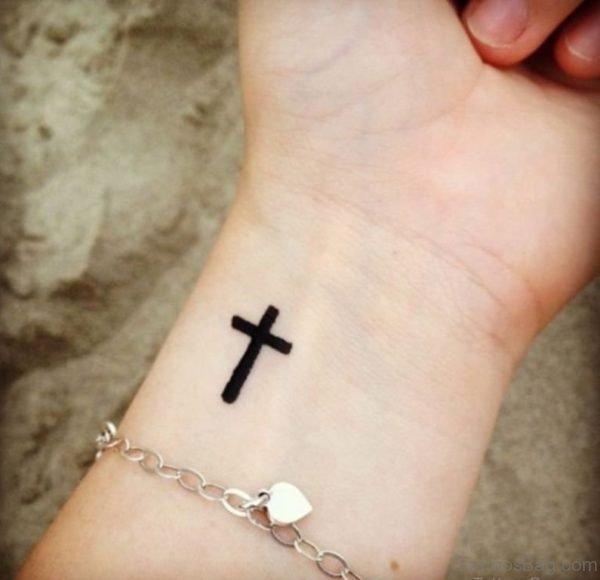 Black Cross Tattoo On Wrist