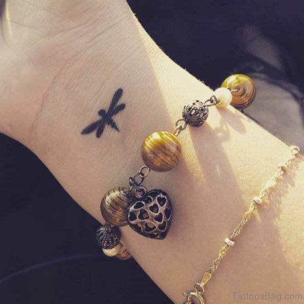 Black Dragonfly Tattoo On Wrist