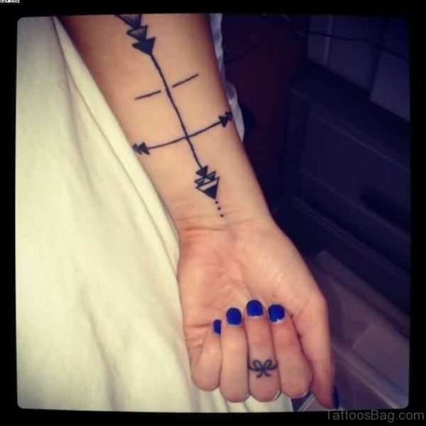 Black Ink Arrow Compass Tattoo On Wrist
