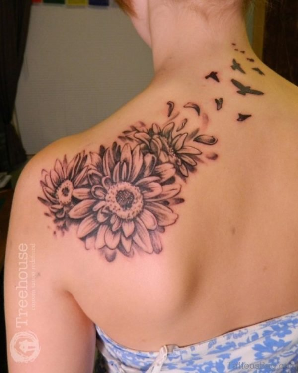 Black Ink Daisy Flowers Tattoo On Girl Left Back