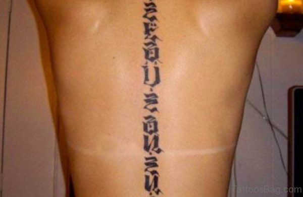 Black Ink Wording Tattoo