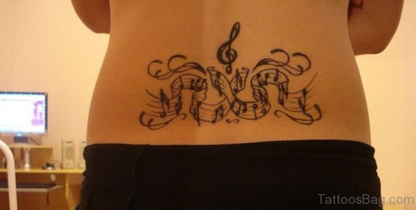 Black Music Notes Tattoo On Lower Back