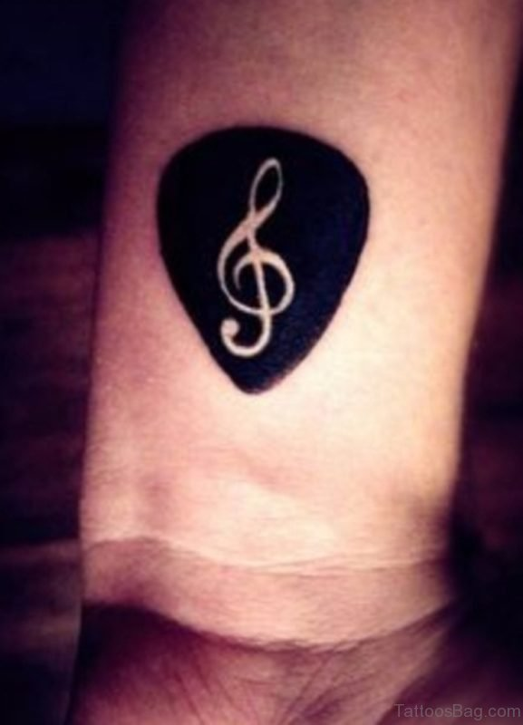 Black Music Note Tattoo On Wrist
