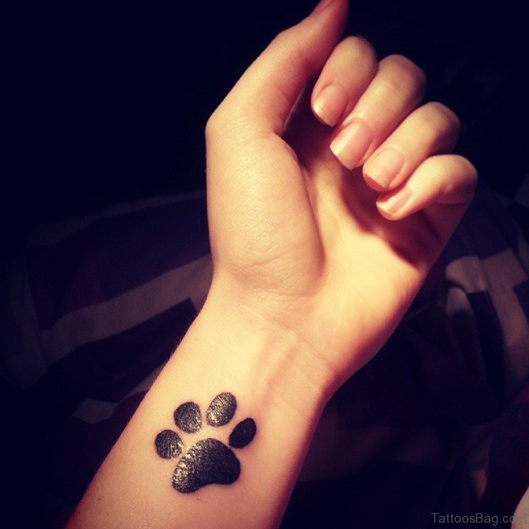 6574345a1 35 Pretty Paw Print Tattoos For Wrist