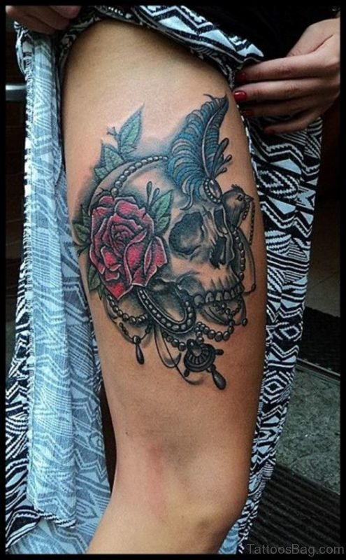 Black Skull And Red Rose Tattoo