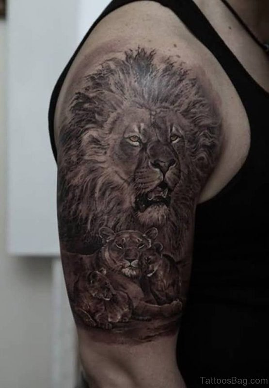 Black Stunning Lion Face Shoulder Tattoo