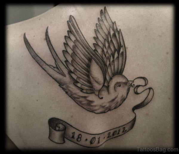Black Swallow Tattoo On Back