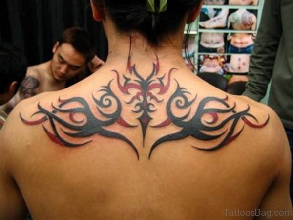 Black Tribal Tattoo On Upper Back