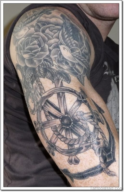 Black Wheel And Flower Viking Tattoo