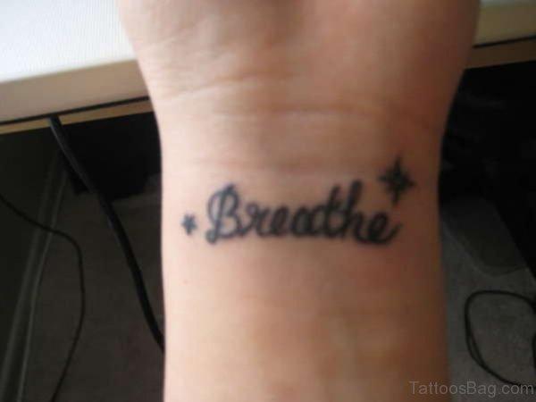 Black Word Breathe Tattoo